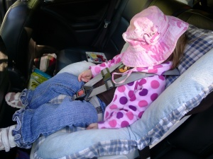 Falling asleep on the way home from the beach. Gotta love the hat