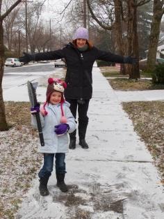 Evie sweeping the sidewalk clean