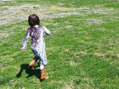 A field of flowers and a girl. Running is just what you have to do!